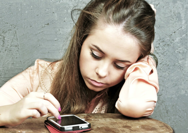 Sad girl with mobile phone