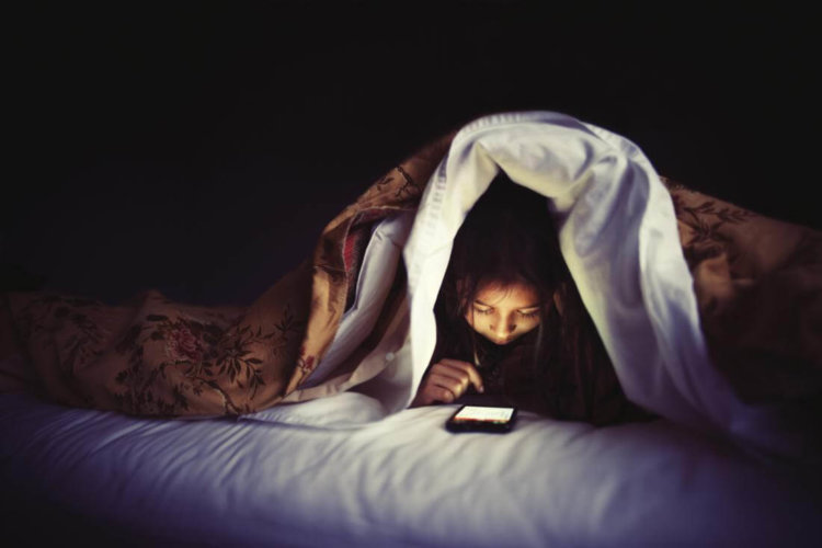 smartphone in the bed